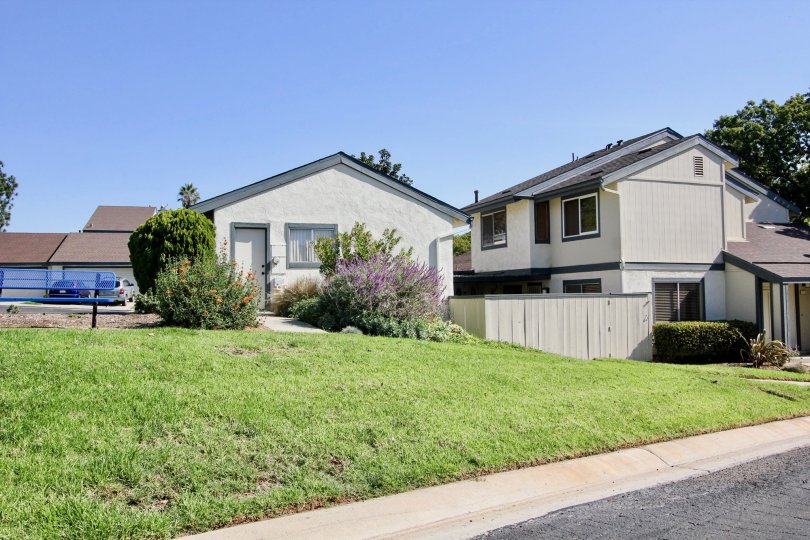 Gray two story home with gray roof in Vallecitos Townhomes at San Marcos CA