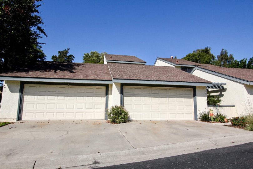 White garages with blue trim at the Vallecitos Townhomes in San Marcos CA