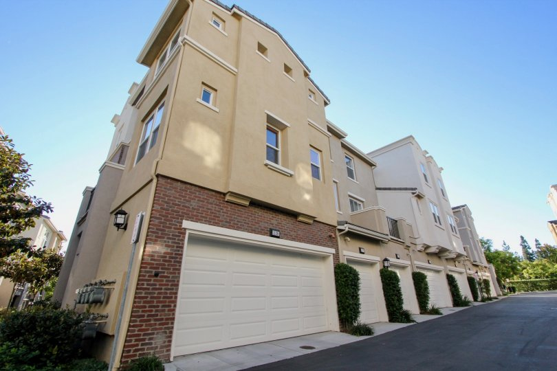 Garages sit on the first floor of a residential building in Village Square