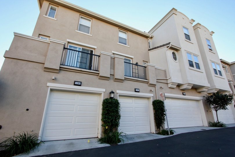Village Square multi-story beige building with white garage doors San Marcos California