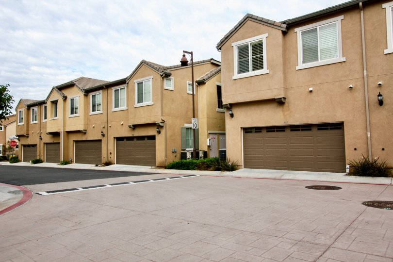 A sunny day in the area of Aubrey Glen, street, parking area, garages, condos