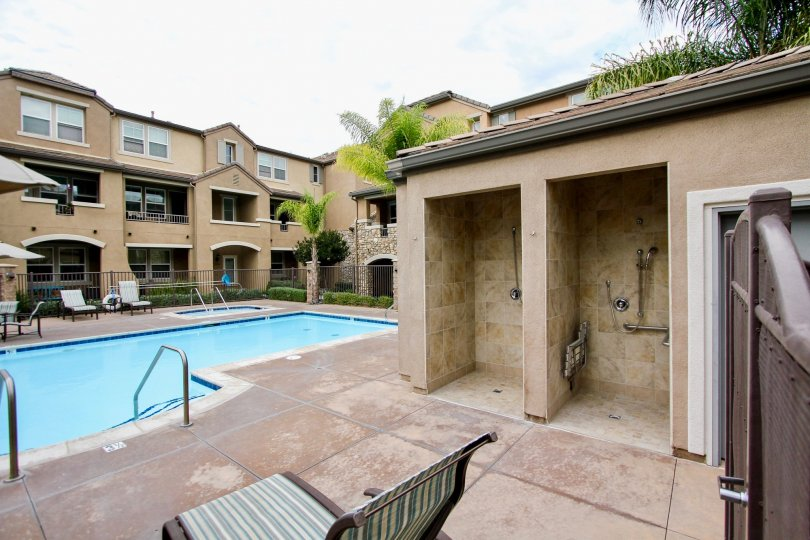 Shower area overlooking lounge and sparkling pool and jacuzzi area in the Aubrey Glen community of Santee.