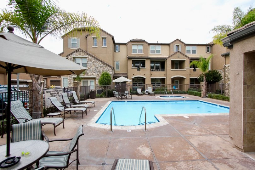 Aubrey Glen community Santee California pool lounge chairs umbrella table arched entry windows