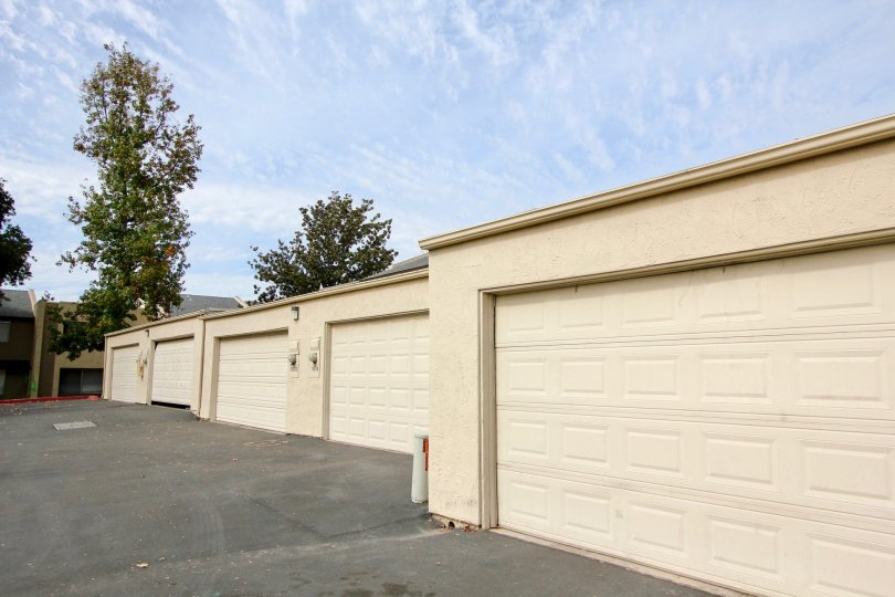 Long shot of light yellow garage doors in Santee, California