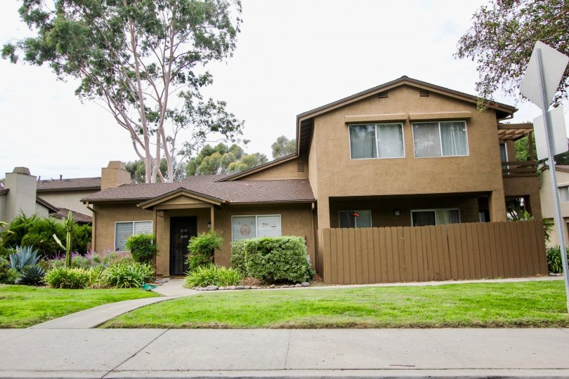 A brown 2-story residental house in the Highland Trails Community. Santee, California.
