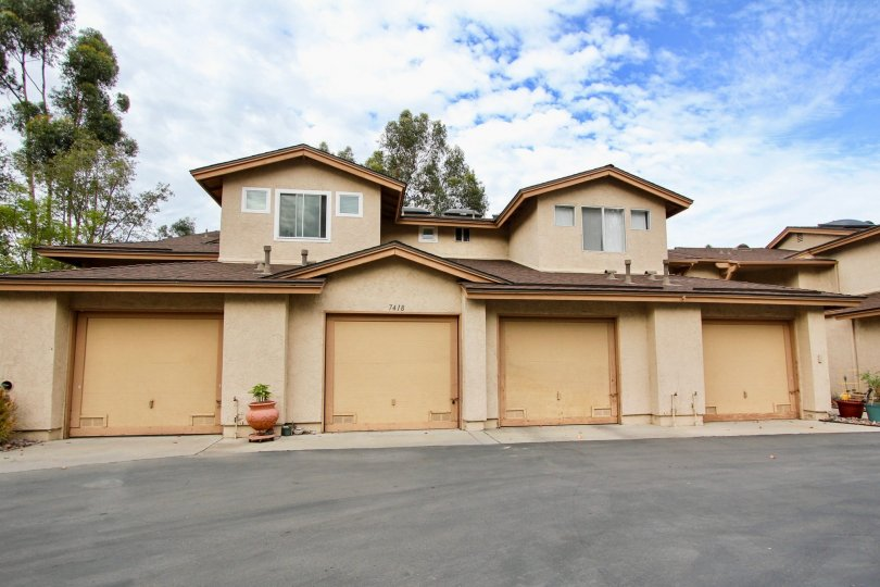 Beautiful home with four car garage in the Highland Trails are of Santee California in a natural setting.