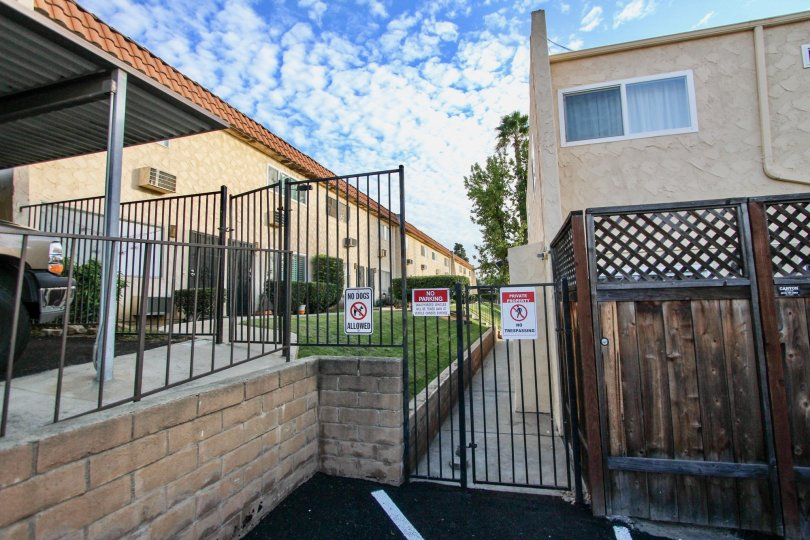 A sunny day in the area of Horizon Village, gated entrance, warning signs, fence, parking lot