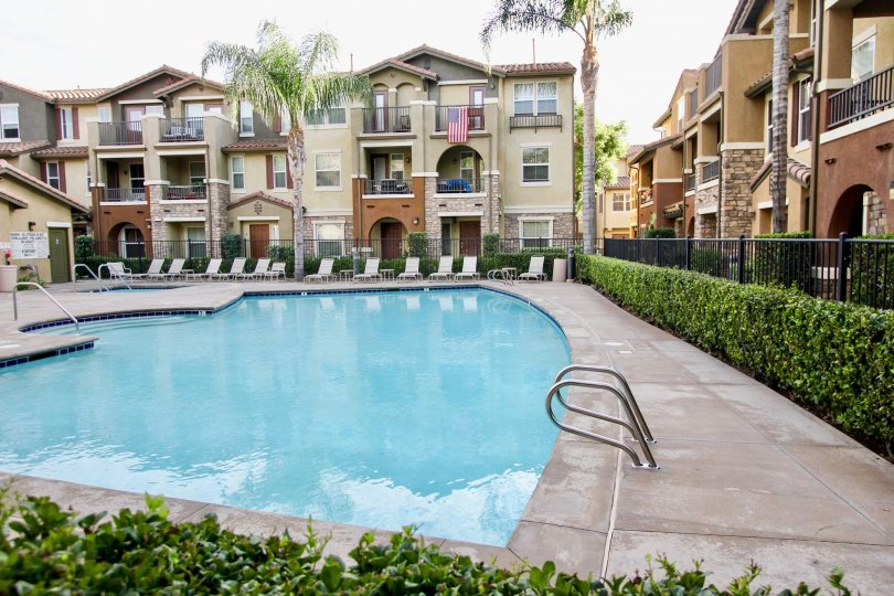 Morningside community Santee California pool hedge castle like decor balconies doors windows arches