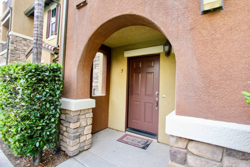 brown door with an archway leading to it in Morningside
