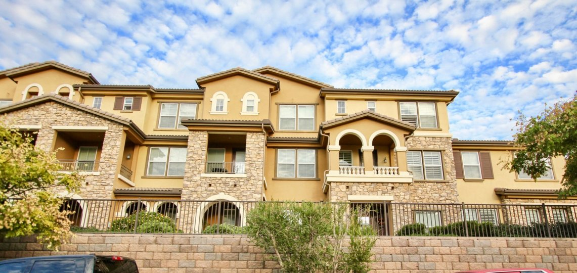 Three story residence units with stone bricks inside the Northstar in Santee CA