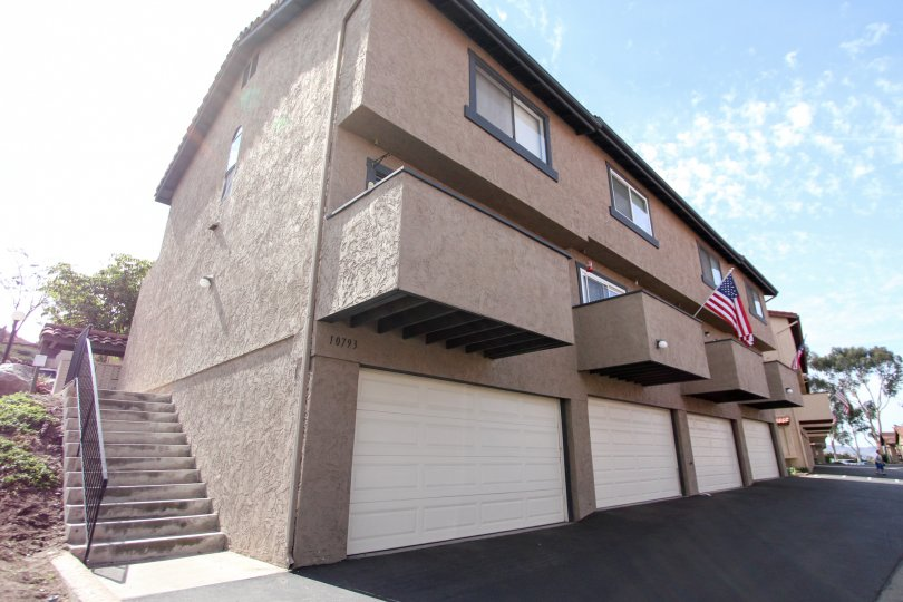Three story housing with patios and garages at Riderwood Terrace in Santee CA
