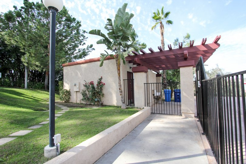 A gateway with palm trees and manicured lawn in Riderwood Terrace