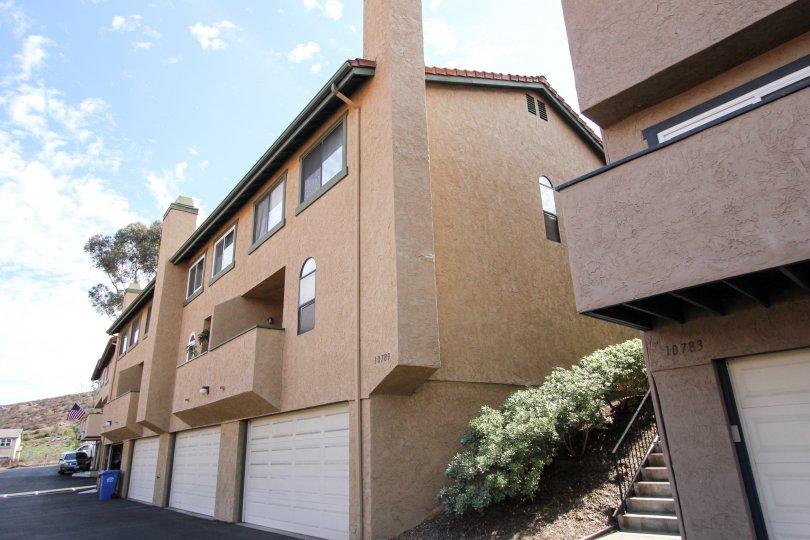 Riderwood Terrace, Santee , California,bushes. brown building
