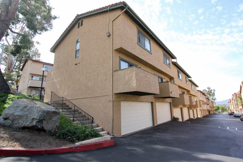 Private balconies and tuck-under garages at Riderwood Terrace in Santee, California.