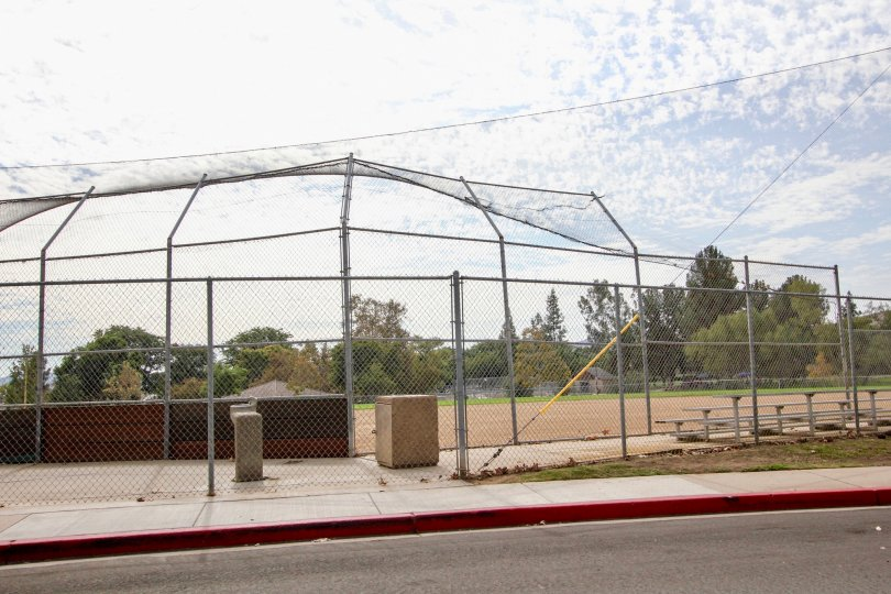 A sunny day in the area of Riderwood Village, baseball diamond, fence, water fountain