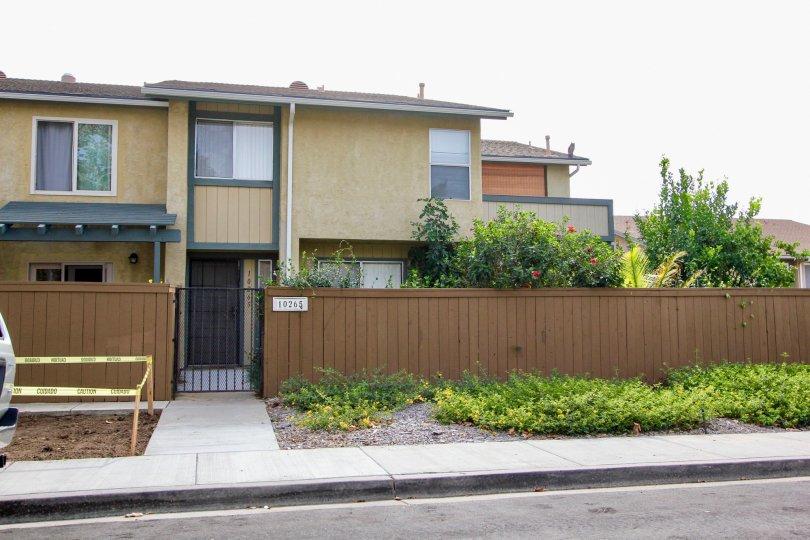iderwood Village  ,: Santee  , California,brown building, plants