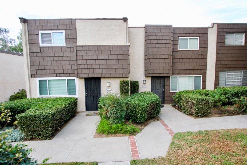 Rio Terrace, Santee, California, wood tiles, two story, bushes