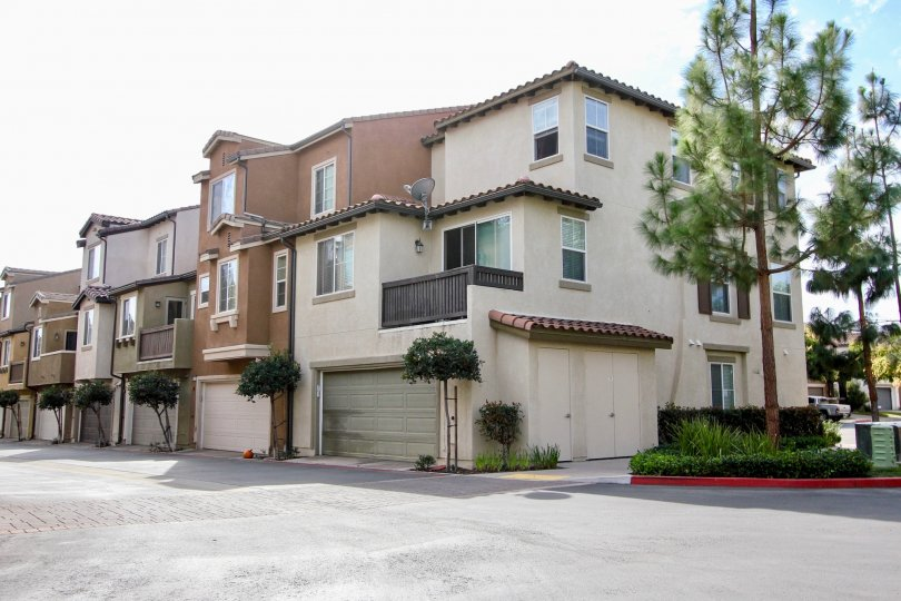 Three story residential buildings with attached garages at Riverwalk in Santee California