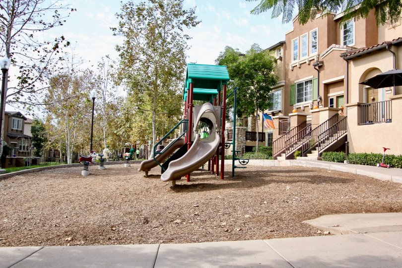 Riverwalk , Santee  , California, kid's slide,light brown building