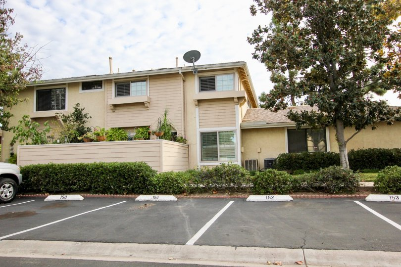 Cream apartment complex and street view in Tamberley, Santee CA