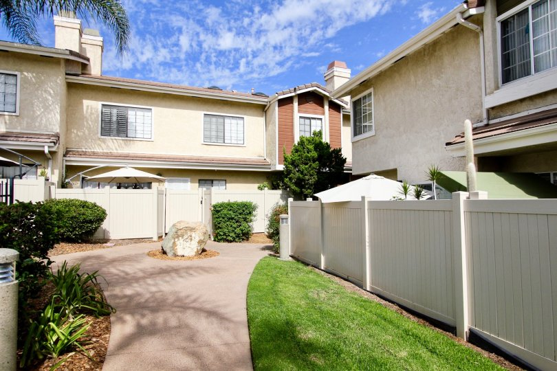 Palm trees and blue skies at the Lakes with private fenced patios in Santee, California
