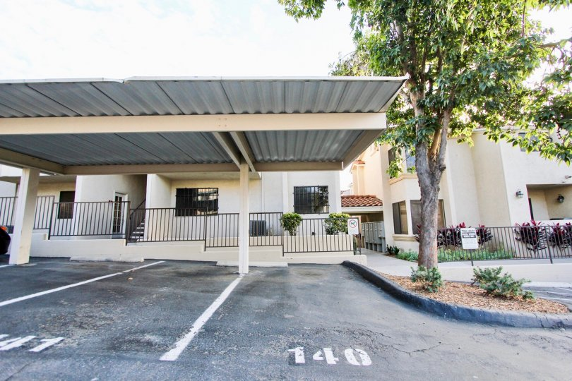 A sunny day in the area of Towne Villas, parking area,