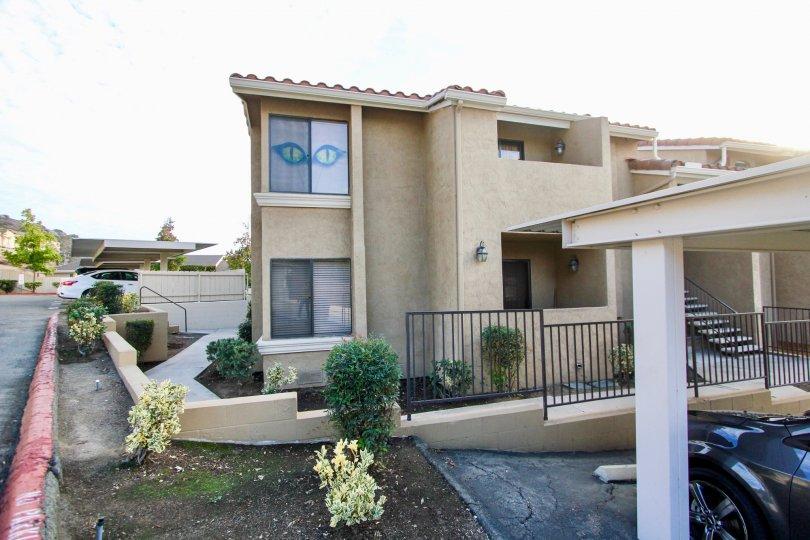 Towne Villas  , Santee  ,California,light brown building,car