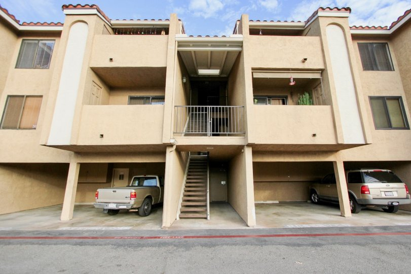 A sunny day in the area of Towne Villas, parking area, truck, suv, balcony