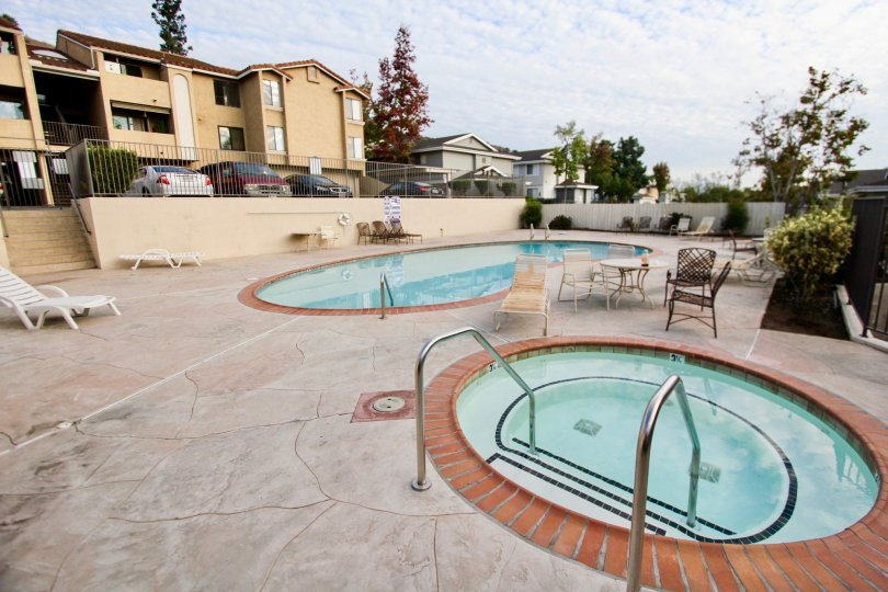 Towne Villas - Santee, California with spacious parking outside of apartments that overlook the community pool and hot tub