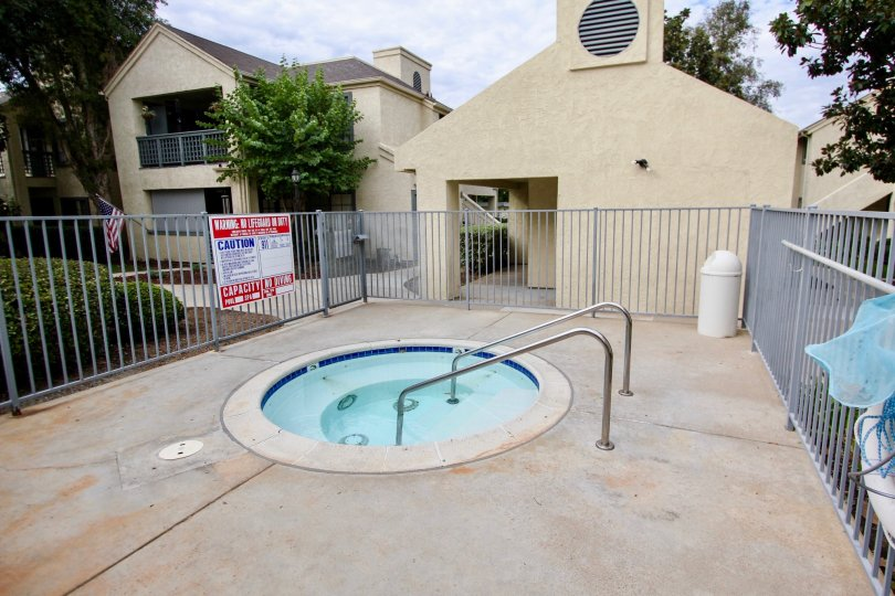 Hot tub surrounded by metal fence at the Vista Del Rio community in Santee California.