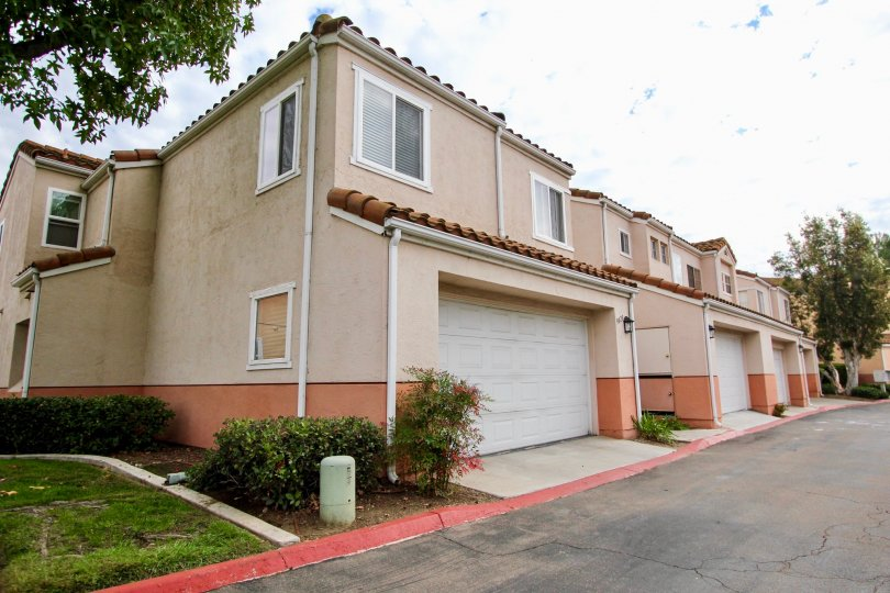Several adobe town homes in Vista Del Verde with drive in garages