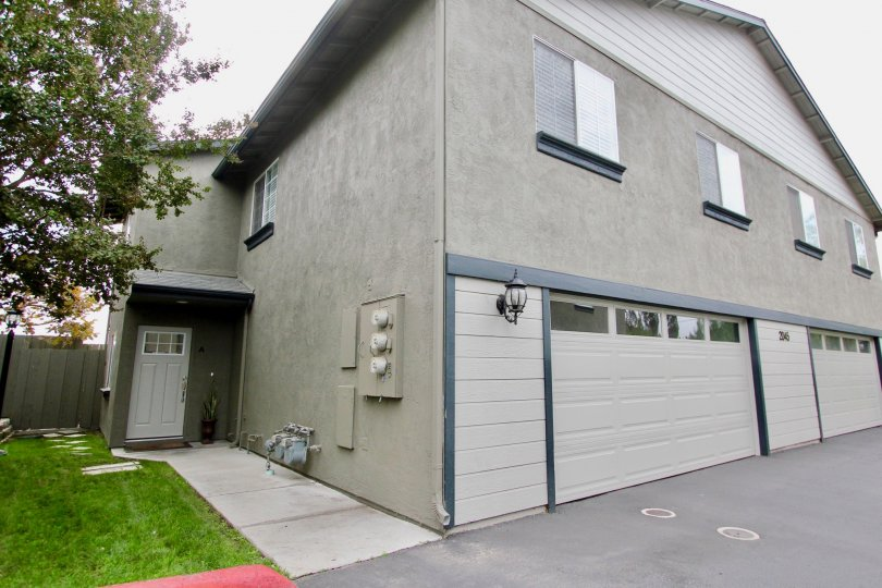 Front of home and garages in Agua Dulce Terrace community of Spring Valley, CA