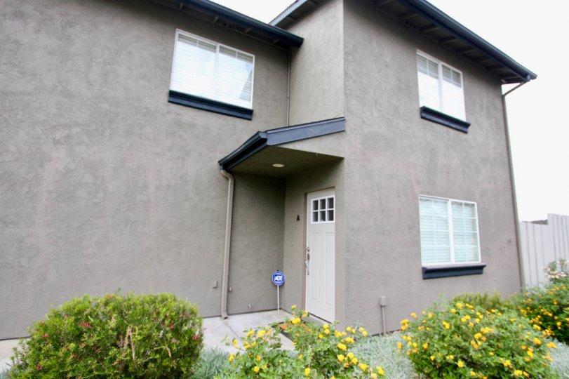 A plain two-storey residence painted in blue and gray in Agua Dulce Terrace neighborhood.