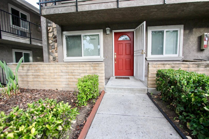 Walkway leading to doorway of a residence at Buena Vista Condominiums in Spring Valley California