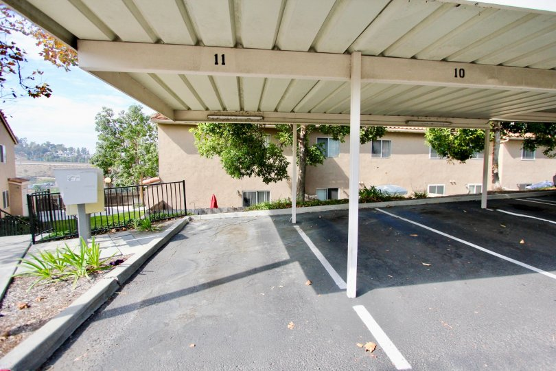 Covered parking spots and a sunny sky in the Quarry Palms Community in Spring Valley, CA.