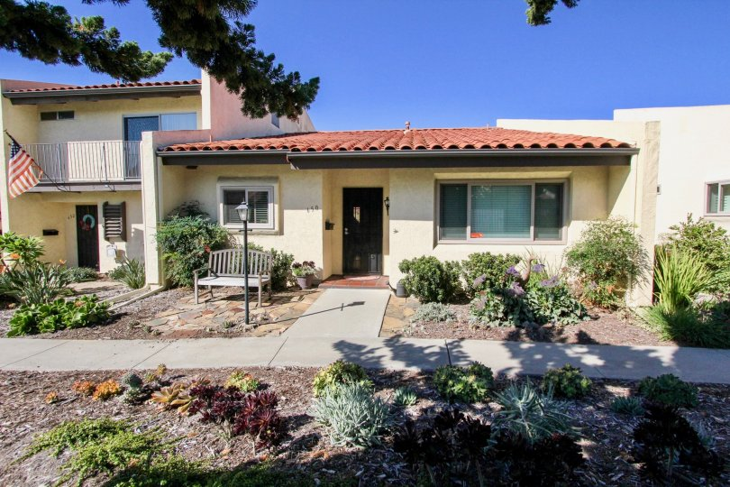 A small  cream colour house  with a garden in Bel Air Vista in Vista.