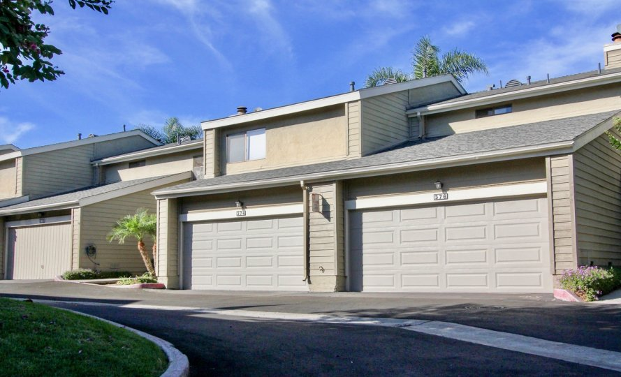 Driveway near housing with attached garages at Bridgecreek in Vista California