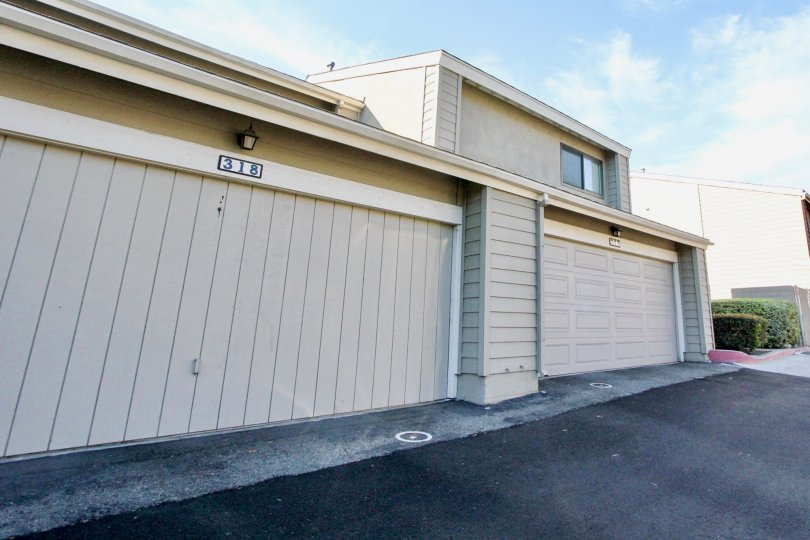 Housing with attached garages near driveway at Bridgecreek in Vista California