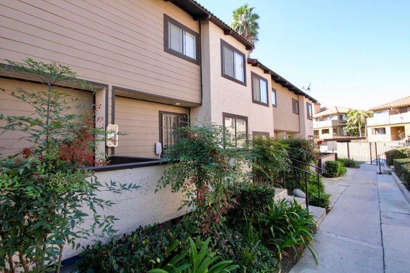 Two story housing with garden plants at Buena Vista Townhomes in Vista California