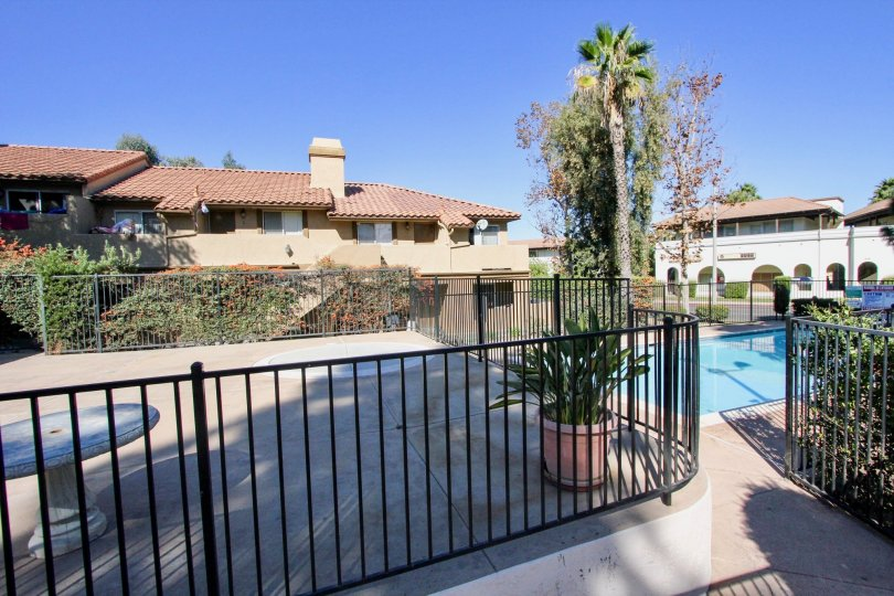 Swimming pool with metal fence at Buena Vista townhomes in Vista California