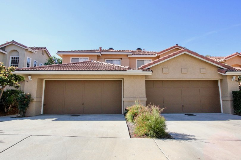 Homes with attached garages with driveways at California Capri in Vista California.