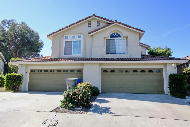Beautiful cream colored home with a red brick roof in Vista, CA