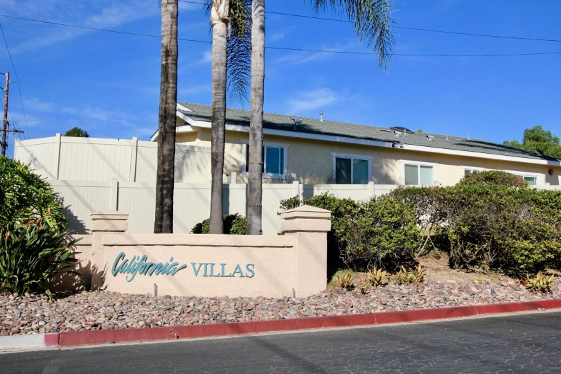 A beautiful tan sign with vibrant blue letters for the entrance of California Villas in Vista, California