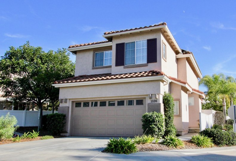 Two story housing with attached garage at Calypso in Vista California