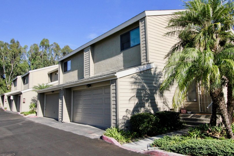 Housing with attached garages at Durian Place Townhomes in Vista California