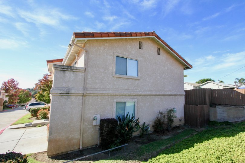 Two story housing with driveway at Hillview Townhomes in Vista California