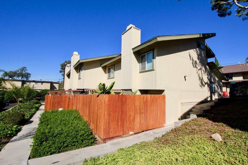 Sunny backyard sidewalk of he Marlin Terrace complex in Vista, California