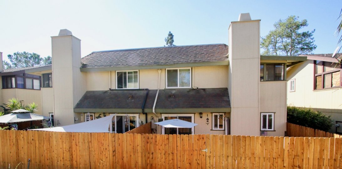 Two story townhomes with wooden fence at Marli Terrace in Vista California