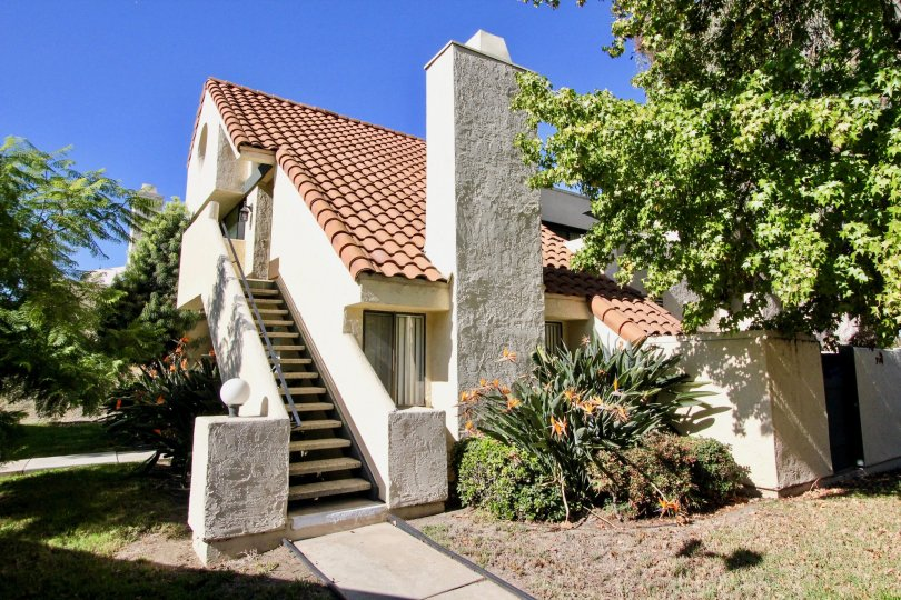 White building with a Spanish style tile roof in Melrose Park, CA