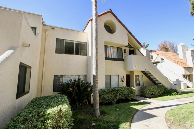 Double level residence landscaped with native flora at Melrose Park in Vista, CA